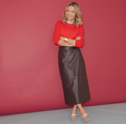 Jess Cartner-Morley in red top against pink background
