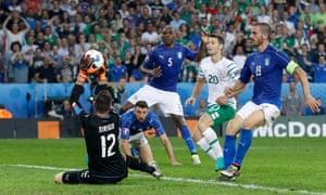 Italy's Salvatore Sirigu saves from Republic of Ireland's Wes Hoolahan.