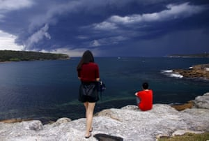 Tourists watch the storm