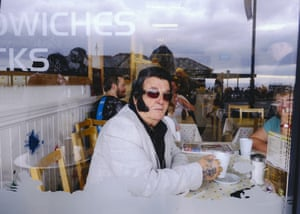 An Elvis fan relaxes in a coffee shop during an annual gathering of Elvis fans and tribute artists which takes place every September in the seaside town of Porthcawl