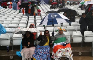 Hopeful fans brave the weather.