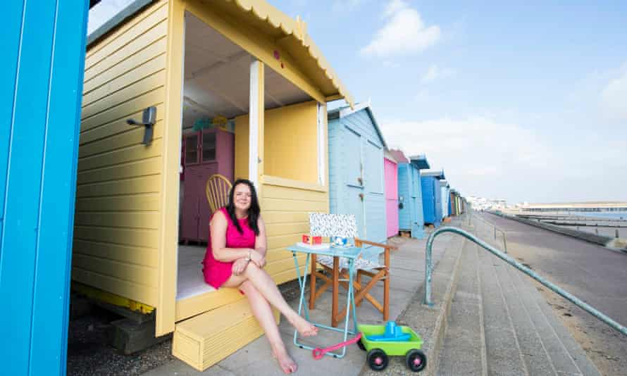 Vicky Gunn, with dog Millie, at her hut in at Walton-on-the-Naze, Essex.