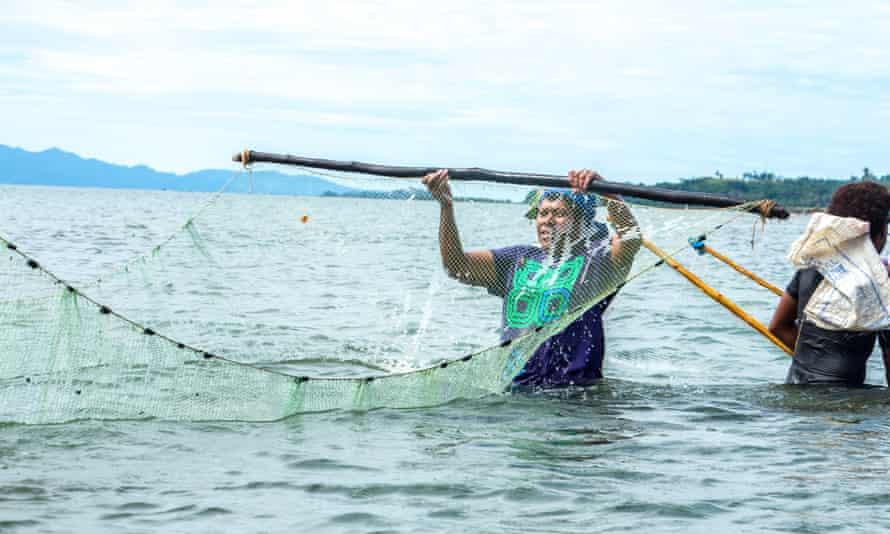 Women fishing a few meters away from the Dawasamu river mouth, in Fiji.