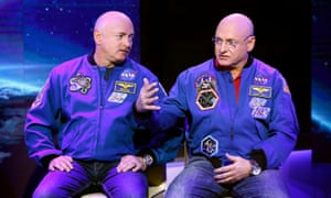 Nasa's identical twin astronauts Scott, left, and Mark Kelly. Nasa will examine how Scott's brain and body change in space, compared with Mark's on the ground.