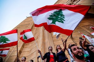 Lebanese demonstrators at the Mohammad al-Amin mosque during the sixth day of protest against tax increases and official corruption in the centre of the capital Beirut's downtown district