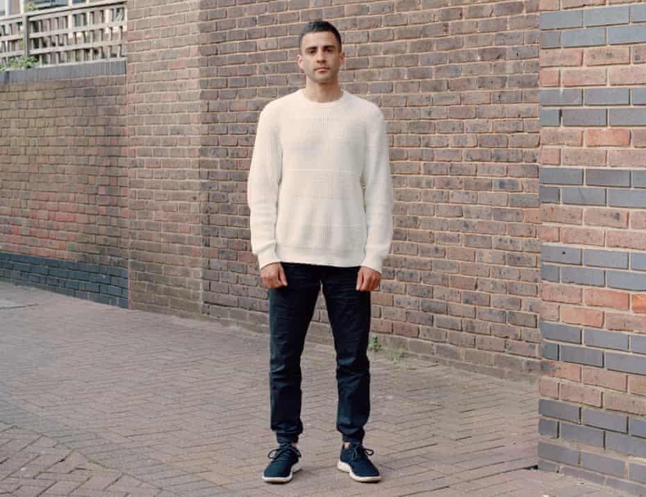 Ciaran Thapar in front of a brick wall