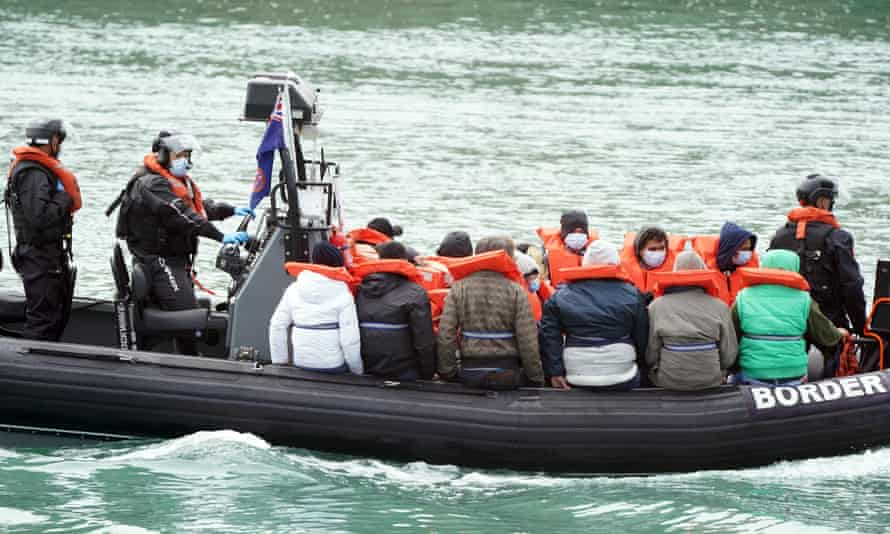 A group of people thought to be migrants are brought in to Dover.