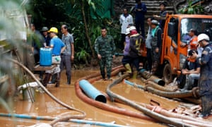 Soldiers and rescue workers work near Tham Luang cave complex