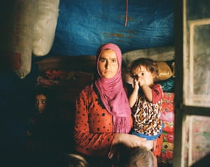 Yusra Abdullah, 23, is living in limbo with her five children in a chicken barn, unable to go home and unable to move.