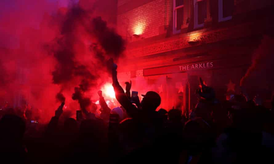 Fans near Anfield before Liverpool's Champions League game at home to Atlético Madrid.