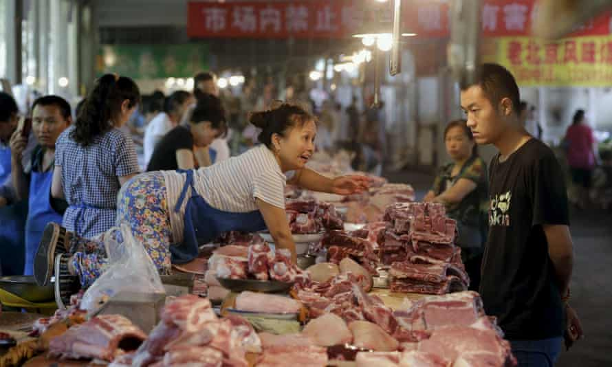 A meat vendor at a market in Beijing