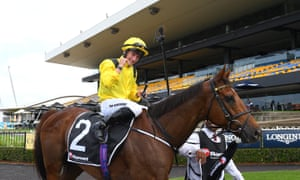 Tom Marquand celebrates in front of an empty grandstand at Rosehill, Sydney after winning the Ranvet on Addeybb.