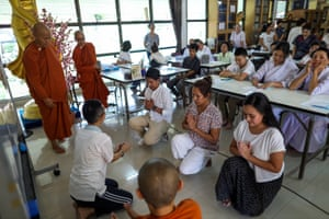 Devotees practice during a first orientation to become Buddhist novice monks