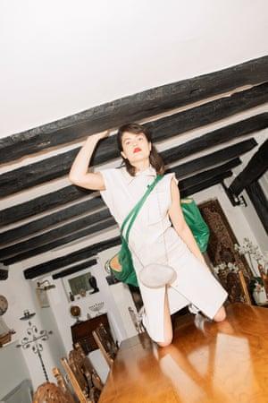 Oversized bags: dress, green bag, stone bag, and knot heels at Bottega Veneta