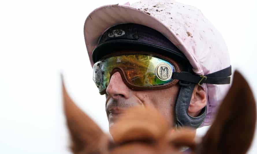 A muddy Gérald Mossé riding on a wet day at Ascot.