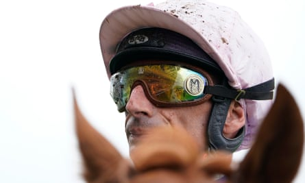 A muddy Gérald Mossé riding on a wet day at Ascot.