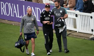 Ollie Pope leaves the field after suffering his injury while playing for Surrey.