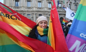 A woman smiles during the Flash Mob 'Wake up Italy' against the discrimination of LGBT people in Milan.