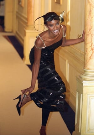Naomi Campbell wears all black, from the fashion house's Autumn/Winter 96/97 haute couture collection