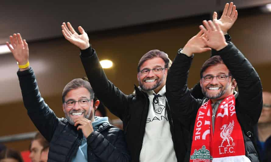 Fans wear Jürgen Klopp masks during the win over Sheffield United; the manager must have been smiling after Liverpool took maximum points from their nine Premier League games over Christmas.