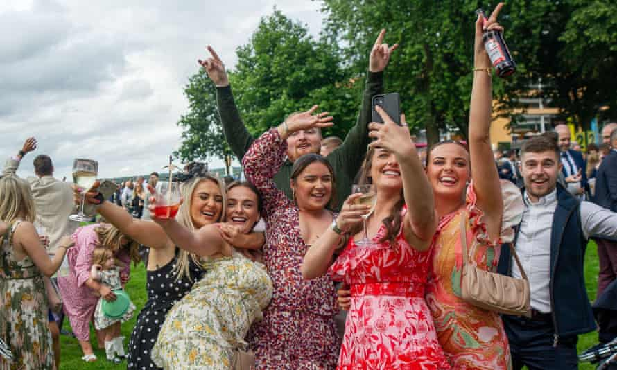 A group of happy racegoers take a selfie during a live concert at Ascot Racecourse