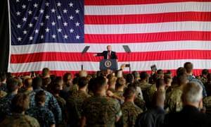 Donald Trump delivers remarks to US military personnel at naval air base in Sicily.