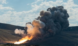 A booster for Nasa's Space Launch System, the rocket that might take humans to Mars, is tested in Promontory, Utah, 28June 2016.