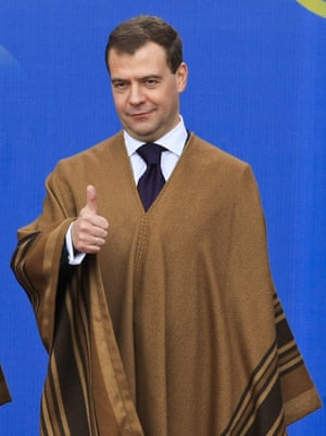 <strong>Peru 2008: </strong>Russia's President Dmitry Medvedev wearing a traditional poncho.