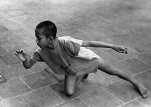 Boy Playing Marbles, Java, 1938, by Gotthard Schuh