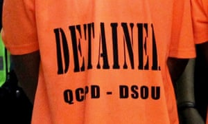 Matthew George Marney was photographed in custody wearing an orange T-shirt similar to that pictured bearing the acronym for the investigation arm of the Philippine police force.