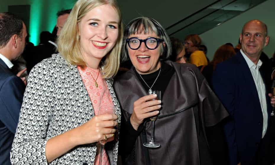Philippa Perry with her daughter Flo, smiling at the camera, champagne flutes in their hands, and dressed up at an event