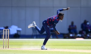 Chemar Holder of West Indies bowls in a warm-up match at Old Trafford.