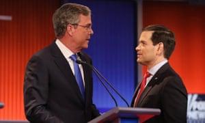 Jeb Bush and Marco Rubio talk at the Republican debate in Des Moines, Iowa, on Thursday.