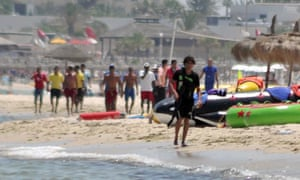 Screengrab of Seifeddine Rezgui being chased off the beach by locals in Sousse, Tunisia after shooting 38 foreign tourists.