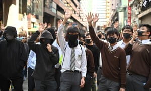 High school students protest during a lunchtime rally in Hong Kong.