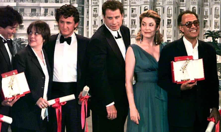 A posed line-up at Cannes, L to R: Chinese director Wong Kar-Wai, British actress Kathy Burke, US actor Sean Penn, US actor John Travolta, French actress Catherine Deneuve and Iranian director Abbas Kiarostami