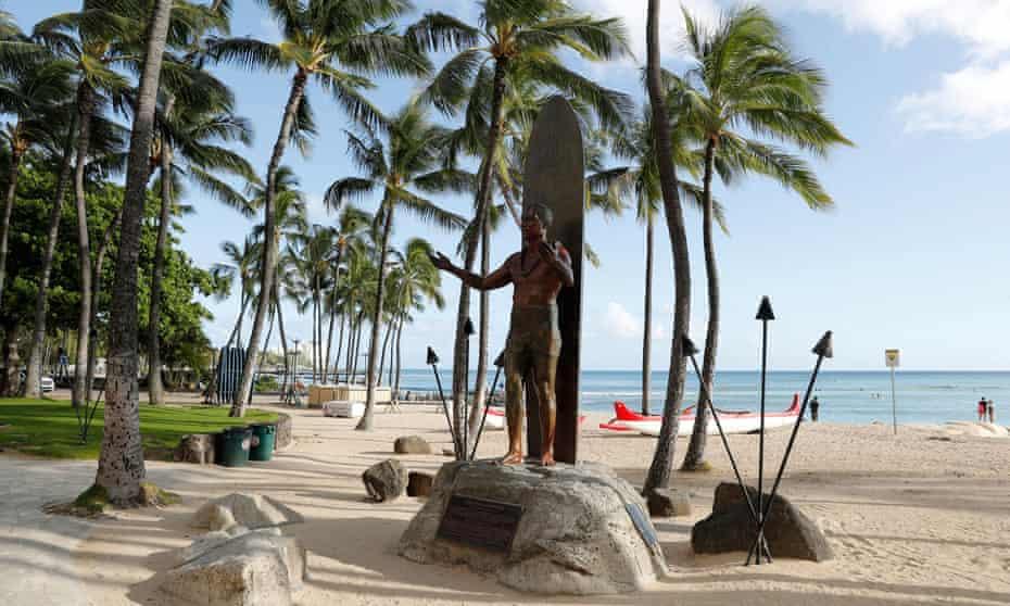Waikiki Beach is nearly empty amid the coronavirus pandemic.
