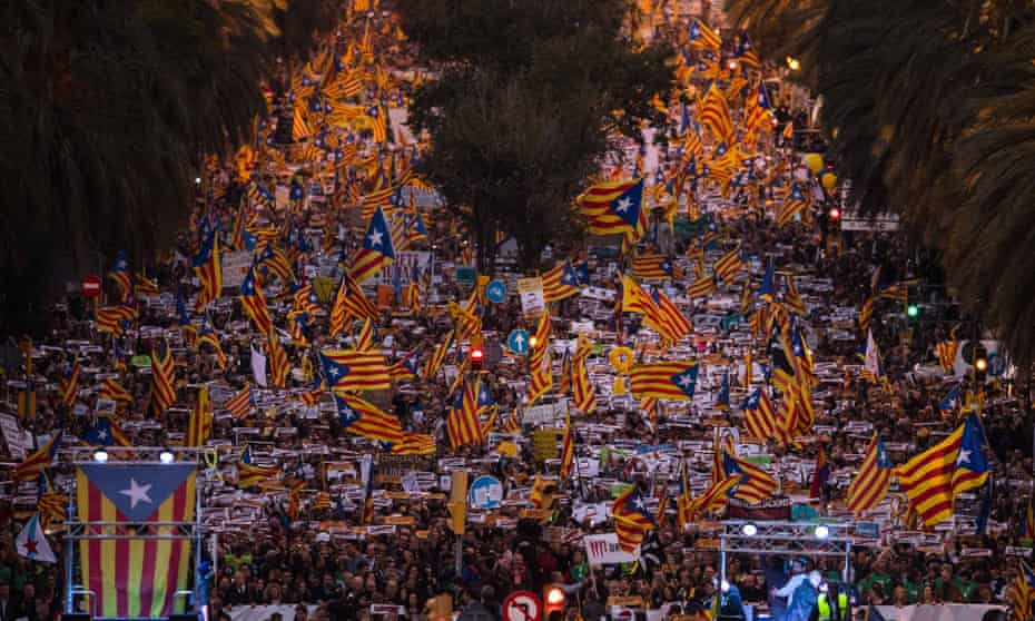 Pro-independence demonstrators march in Barcelona against the imprisonment of ousted members of Catalan government.