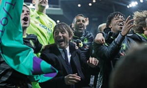 Antonio Conte joins the celebrations after the full-time whistle.