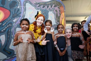 Yellow Wiggle Emma with Katie Noonan and Yarrabah State School students.