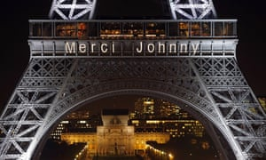 The words 'Merci Johnny' are displayed on the Eiffel Tower