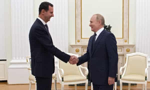 Vladimir Putin greets Bashar al-Assad at a meeting in Moscow earlier in September.