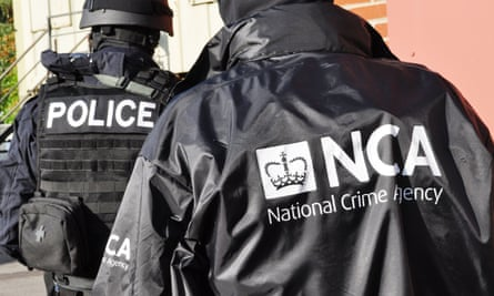 A National Crime Agency officer.