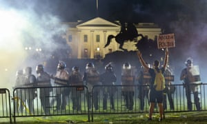 Riot police face protesters in Lafayette Park, yards from the White House, on Sunday night.