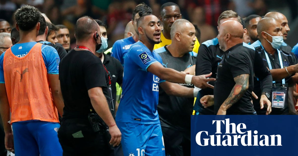 Nice v Marseille suspended after players and fans clash on pitch