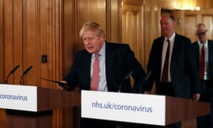 Boris Johnson arrives at a news conference on 12 March.