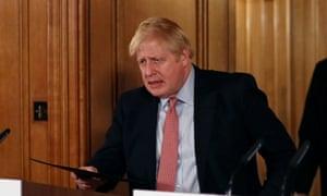 The UK prime minister, Boris Johnson, arriving at a coronavirus press conference.