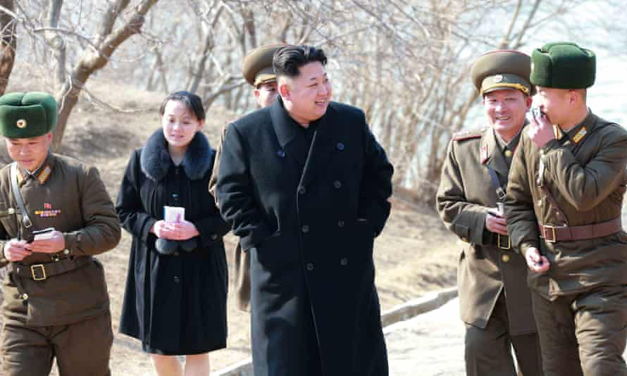 North Korean leader Kim Jong-un (C) touring a military unit on an island off the North Korean mainland near the sea border with South Korea in the East Sea. Kim's younger sister, Yo-jong, is seen behind.