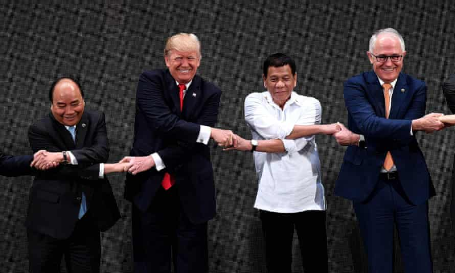 Vietnam's prime minister, Nguyen Xuan Phuc, US president Donald Trump, Philippine president Rodrigo Duterte and Australian prime minister Malcolm Turnbull, link hands at the Asean summit in 2017.