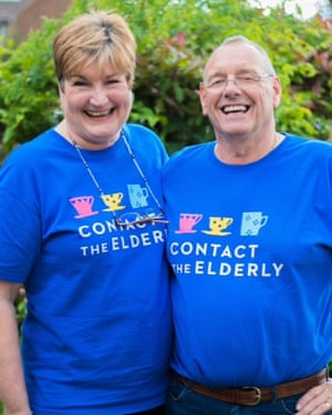 """A man and woman smiling and wearing t shirts saying """"Contact the Elderly"""""""